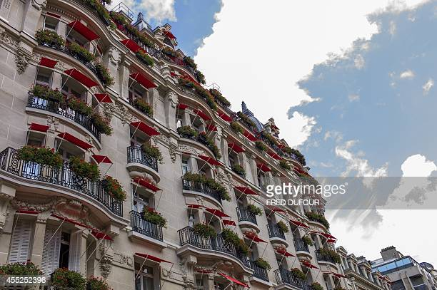 A picture taken on August 19 2014 in Paris shows the facade of the Plaza Athenee hotel The Plaza Athenee reopened its doors on September 82014 after...