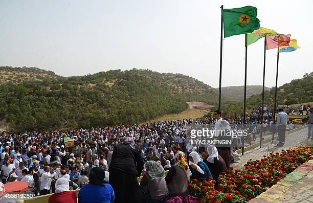 A picture taken on August 19 2014 shows people attending the funeral ceremony of Mehdi Taskin who died during clashes that erupted between protesters...