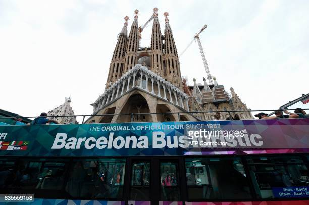 A picture taken on August 19 2017 shows a city tour bus in front of the 'Sagrada Familia' basilica in Barcelona two days after a van ploughed into...