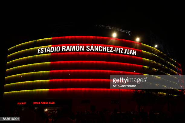 A picture taken on August 19 2017 shows the Ramon SanchezPizjuan stadium illuminated with the colours of the Catalan flag in tribute to the victims...