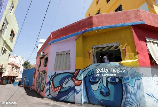 A picture taken on August 19 shows painted houses in Beirut's southern Ouzai neighbourhood Starting 18 months ago Nasser began implementing a plan to...