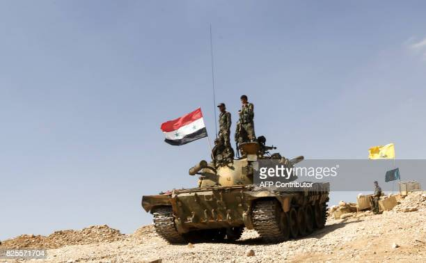 A picture taken on August 2 2017 during a tour guided by the Lebanese Shiite Hezbollah movement shows members of the Syrian government forces riding...