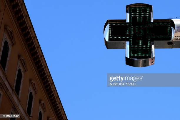 A picture taken on August 2 2017 shows the thermometer of a pharmacy in central Rome as temperatures reached 45 degrees Celsius / AFP PHOTO / Alberto...