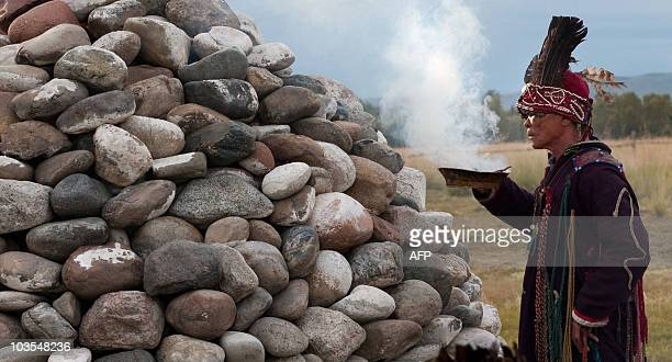 A picture taken on August 20 2010 shows a shaman of Tyva Republic attending a shamanistic ritual ceremony at sacred site outside Kyzyl AFP PHOTO /...