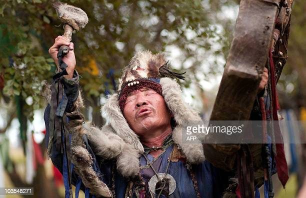 A picture taken on August 20 2010 shows a shaman of Tyva Republic performing during a shamanistic ritual ceremony at sacred site outside Kyzyl AFP...