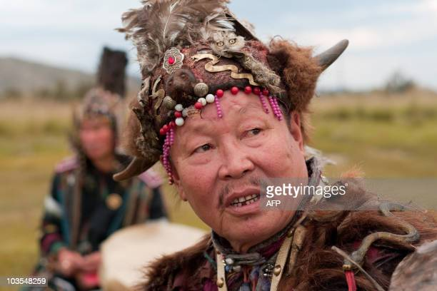 A picture taken on August 20 2010 shows Dopchyunool Katraool Supreme shaman of Tyva republic looks on as he attends a shamanistic ritual ceremony at...