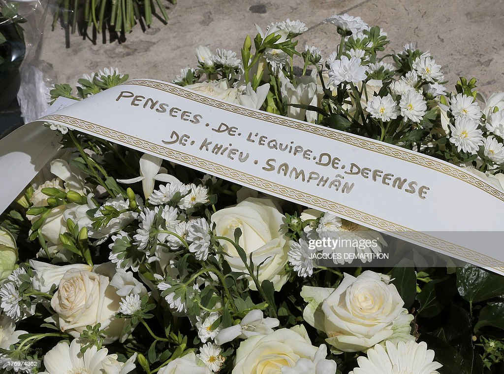 A picture taken on August 20, 2013 shows a wreath of flowers with the inscription ''thoughts from the defense team of Khieu Samphan'' during the funeral ceremony of Jacques Verges at the Saint-Thomas d'Aquin Church in Paris. Jacques Verges, the provocative French lawyer who earned the nickname 'Devil's advocate' by defending a series of high-profile criminals from Klaus Barbie to Carlos the Jackal, died in Paris on August 15, 2013 aged 88. Verges died of a heart attack around 8:00pm (1800 GMT) in the house where 18th century enlightenment philosopher Voltaire once lived -- an appropriate setting for an iconoclast who devoted his life to defending unpopular causes, according to his publishing house Pierre-Guillaume de Roux. One of his last high-profile cases was the defence in 2011 of his long-time friend, Cambodia's former communist head of state Khieu Samphan, who faced charges of crimes against humanity over the 1975-1979 Khmer rule.