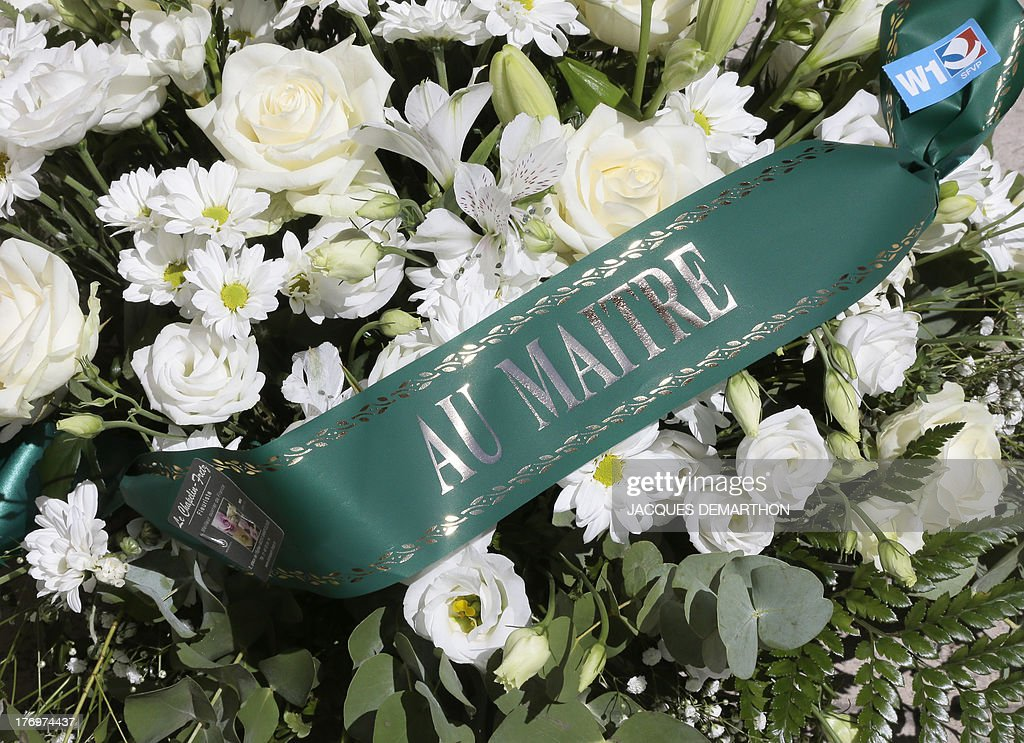 A picture taken on August 20, 2013 shows a wreath of flowers with the inscription ''to the master'' during the funeral ceremony of Jacques Verges at the Saint-Thomas d'Aquin Church in Paris. Jacques Verges, the provocative French lawyer who earned the nickname 'Devil's advocate' by defending a series of high-profile criminals from Klaus Barbie to Carlos the Jackal, died in Paris on August 15, 2013 aged 88. Verges died of a heart attack around 8:00pm (1800 GMT) in the house where 18th century enlightenment philosopher Voltaire once lived -- an appropriate setting for an iconoclast who devoted his life to defending unpopular causes, according to his publishing house Pierre-Guillaume de Roux. One of his last high-profile cases was the defence in 2011 of his long-time friend, Cambodia's former communist head of state Khieu Samphan, who faced charges of crimes against humanity over the 1975-1979 Khmer rule.