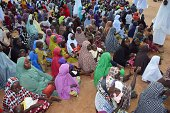 A picture taken on August 21 2014 shows Internally Displaced People sitting in Mubi camp in Nigeria's northeastern Adamawa State Mostly women and...