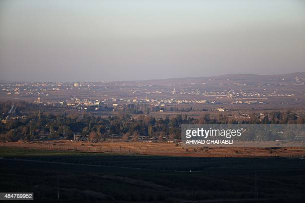 A picture taken on August 21 2015 from the Israeliannexed Golan Heights along the ceasefire line separating the Syrian part of the Golan Heights from...