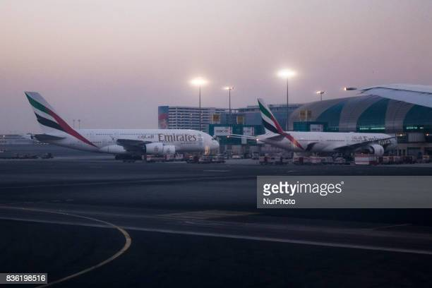 A picture taken on August 21 2017 shows an Emirates airline Boeing 777 parked on the tarmac at Dubai airport UAE Dubai International Airport the...