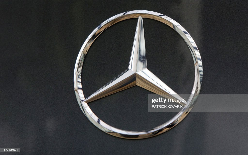 A picture taken on August 22 2013 shows a Mercedes star the logo of German auto giant Daimler's brand Mercedes Benz at a car dealer in RueilMalmaison...