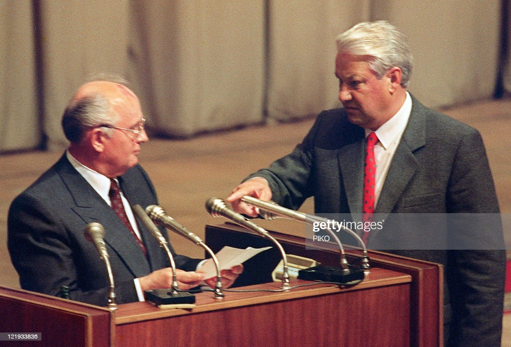 A picture taken on August 23 1991 shows Russian President Boris Yeltsin gesturing towards Soviet President Mikhail Gorbachev in Moscow while he...