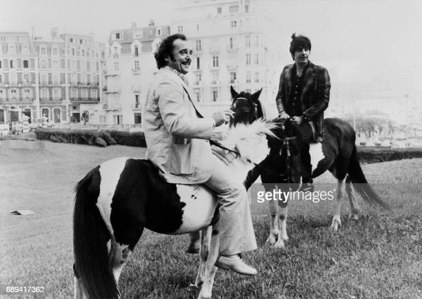 A picture taken on August 24 1974 shows late French actor JeanMarc Thibault and late French actor Roger Pierre riding 'Poottoks' little wild poneys...