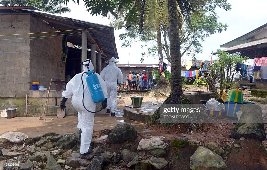A picture taken on August 25, 2014 in Monrovia shows nurses wearing a protective suit searching for a man infected with the Ebola virus to escort him to a hospital in Monrovia. The United Nations vowed on August 23 to play a 'strong role' in helping Liberia and its neighbours fight a deadly outbreak of Ebola in west Africa, which it said could take months to bring it under control. Liberia has been particularly hard hit by the epidemic that has swept relentlessly across the region since March, accounting for almost half of the 1,427 deaths.