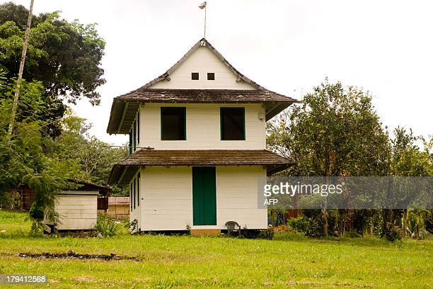 A picture taken on August 26 2013 shows a house in Saul a tiny village in French Guiana in the Amazonian forest Located at 180 kms south of Cayenne...
