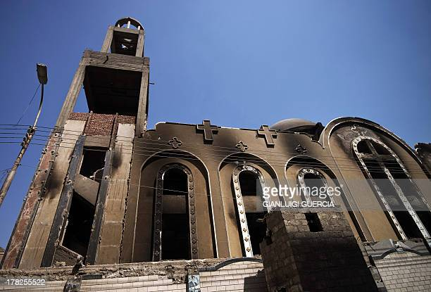 A picture taken on August 27 2013 shows a facade of Amba Moussa Coptic church that was torched by unknown assailants in the central Egyptian city of...