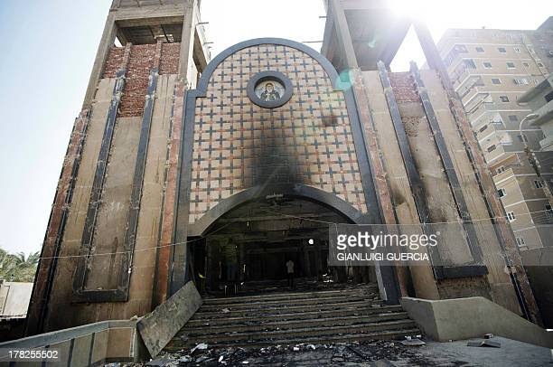 A picture taken on August 27 2013 shows the facade of Amba Moussa Coptic church that was torched by unknown assailants in the central Egyptian city...