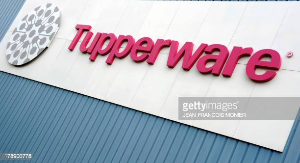 Picture taken on August 27 2013 shows the logo of the Tupperware Brands Corporation at the entrance of the factory in JouelesTours centre France on...