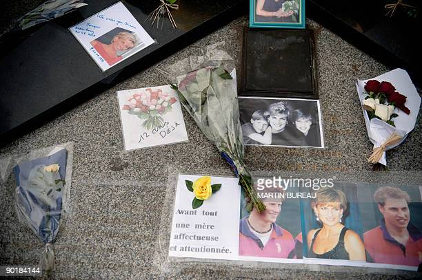 Picture taken on August 30 2009 shows flowers and pictures of Princess Diana which were laid over the Alma bridge in Paris in memory of the princess...