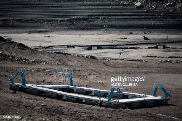 A picture taken on August 30 shows a toboggan aquatic platform among the remains of the old village of Mansilla in La Rioja region usually hidden...