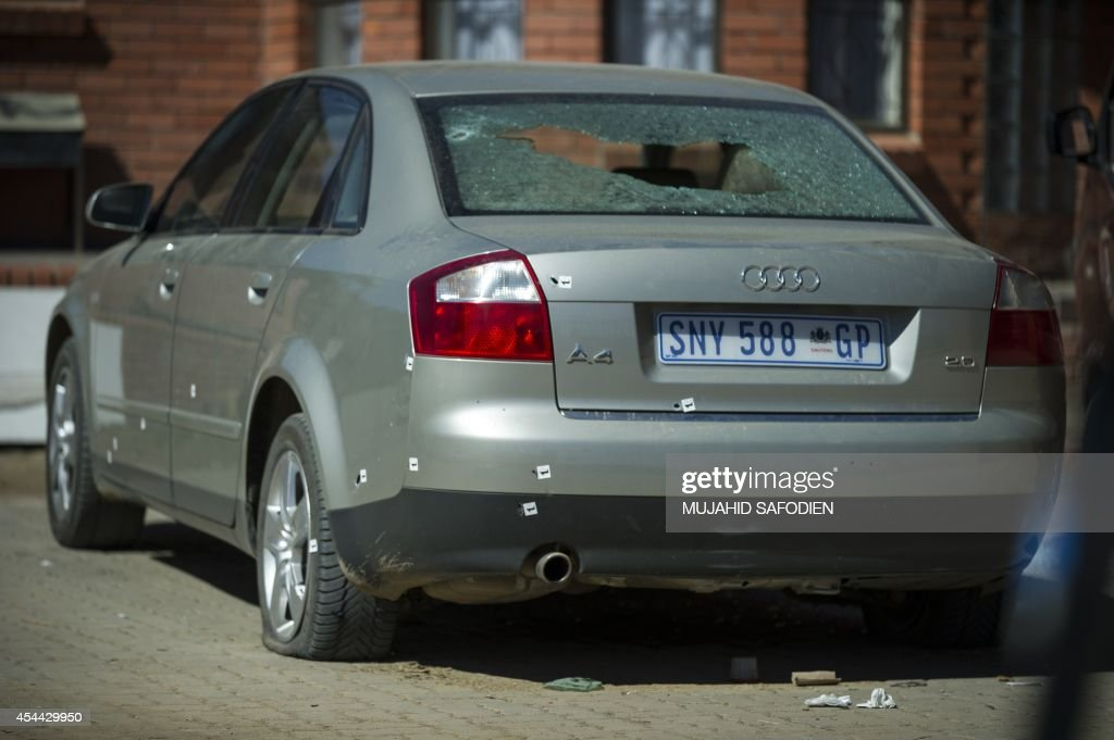 A picture taken on August 31 2014 in Maseru shows the car of Lieutenant general Maaparankoe Mahao damaged during an attempt of assassination Lesotho...