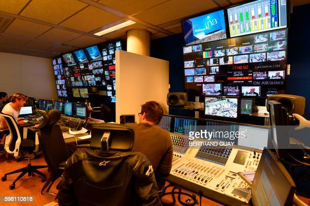 Picture taken on August 31 2016 shows the Franceinfo's TV production control room at the headquarters of France Televisions the French public...