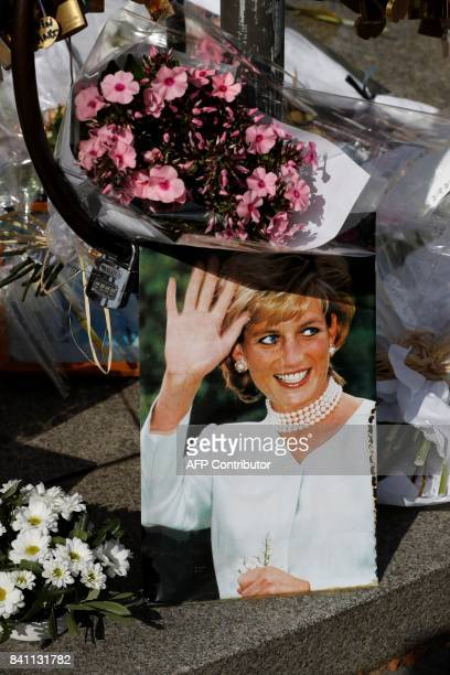 A picture taken on August 31 2017 at the Flame of Liberty monument over the Alma bridge in Paris which became an unofficial memorial for Diana...