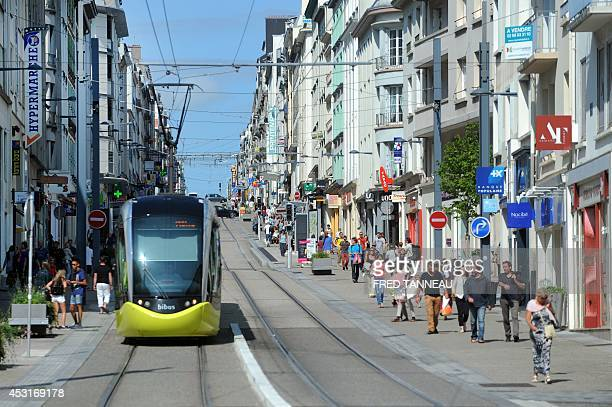 A picture taken on August 4 2014 in Brest western France shows people and a bibus tram in one of the main streets of the city AFP PHOTO / FRED TANNEAU