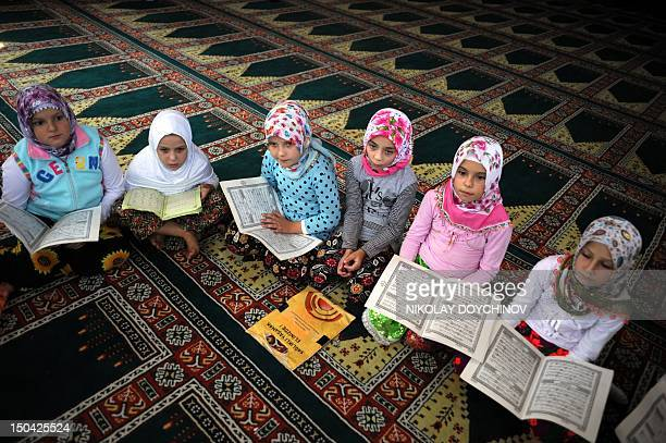 Picture taken on August 5 2012 shows Bulgarian Muslim children reciting verses from Islam's Holy Book during a Koran class in the village Lazhnitsa...