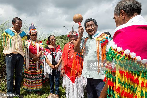 A picture taken on August 8 2015 shows traditional chiefs and a shaman taking part in a traditional ceremony in Cayenne the capital of French Guiana...