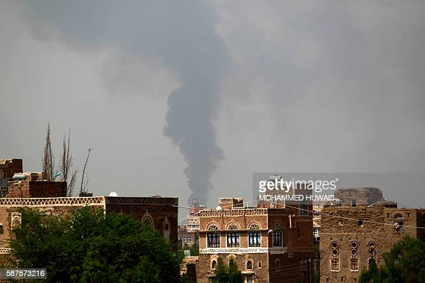 A picture taken on August 9 2016 shows smoke billowing behind buildings following a reported airstrike carried out by the Saudiled coalition that...