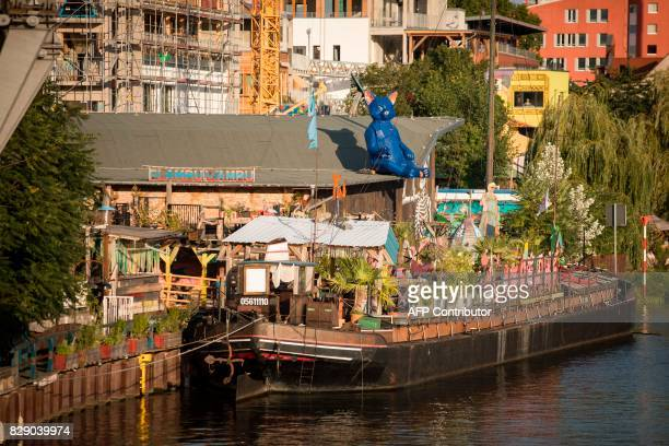 Picture taken on August 9 2017 shows the club 'Kater Blau' part of the urban cooperative project Holzmarkt 25 on the banks of the river Spree in...