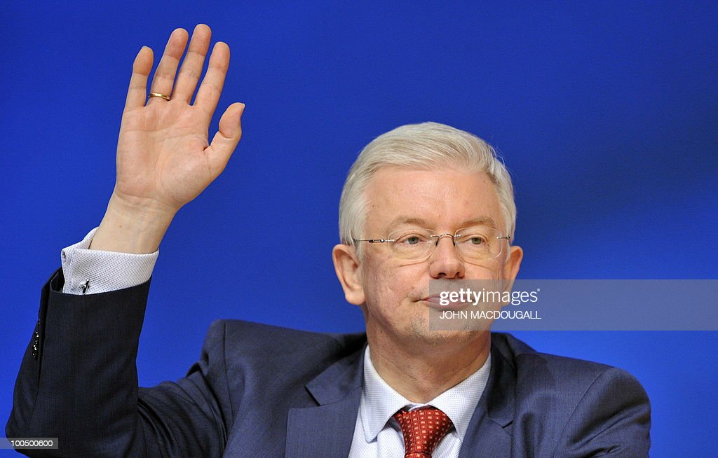 FILES - Picture taken on December 1, 2008 shows Hesse State Premier Roland Koch voting by a show of hands during the annual congress of the Christian Democrats Union (CDU) party in Stuttgart, southern Germany. Koch, a powerful rival of German Chancellor Angela Merkel and a big-hitting regional baron in her party announced his surprise resignation on May 25, 2010, but denied it was due to any spat.