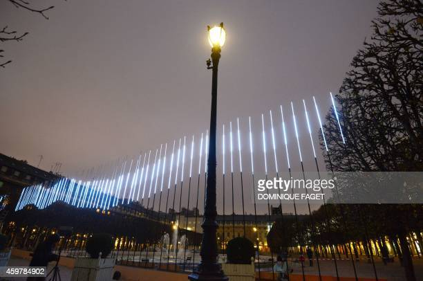 Picture taken on December 1 2014 at the Palais Royal garden in Paris shows the art installation 'Northern Light' by Swedish artist Aleksandra...