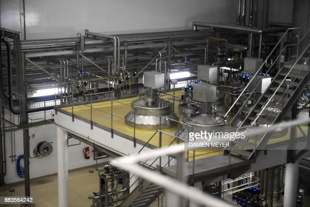 A picture taken on December 1 2017 shows a production line in Laita dairy company's infant milk new factory in Crehen western France / AFP PHOTO /...