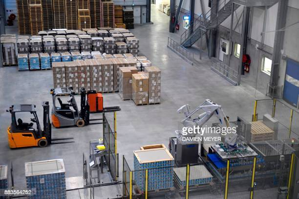 A picture taken on December 1 2017 shows storage area in Laita dairy company's infant milk new factory in Crehen western France / AFP PHOTO / DAMIEN...