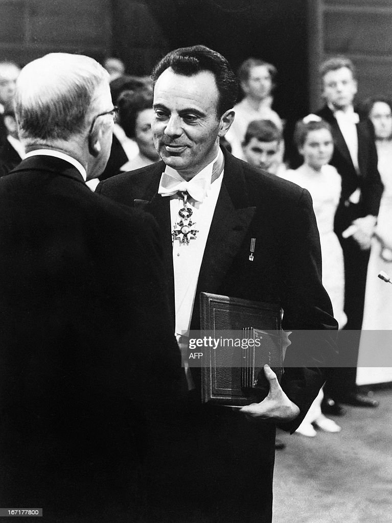 A picture taken on December 10, 1965 at the Stockholm concert Hall shows France's medicine nobel prize laureate Francois Jacob (C) receiving his award during the solemn Nobel prize ceremony. French biologist Francois Jacob, who won the 1965 Nobel prize for medicine for his research into enzymes, has died at the age of 92, a relative told AFP on April 21, 2013.