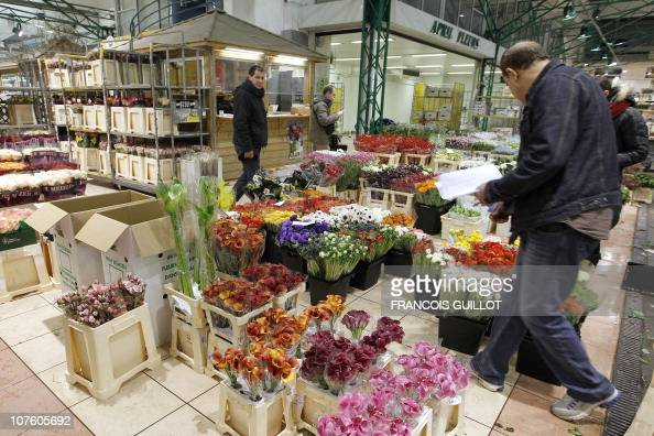 A picture taken on December 10 2010 shows people working in the fresh cut flowers pavilion at Rungis international food market near Paris Rungis...