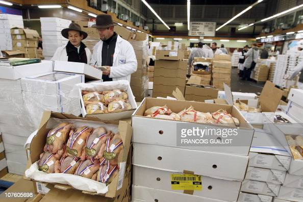 A picture taken on December 10 2010 shows salesmen working at the poultry pavilion at Rungis international food market near Paris Rungis...