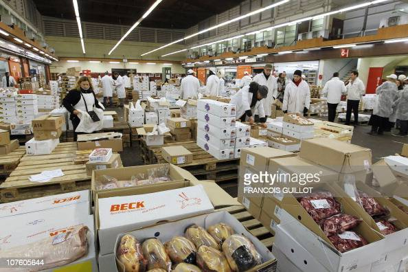 A picture taken on December 10 2010 shows salesmen working in the delicatessen products pavilion at Rungis international food market near Paris...