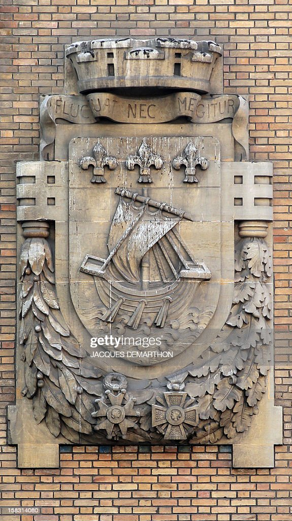 A picture taken on December 12 2012 in Paris in the facade of a public building shows the arms and the motto of the French capital The vessel...