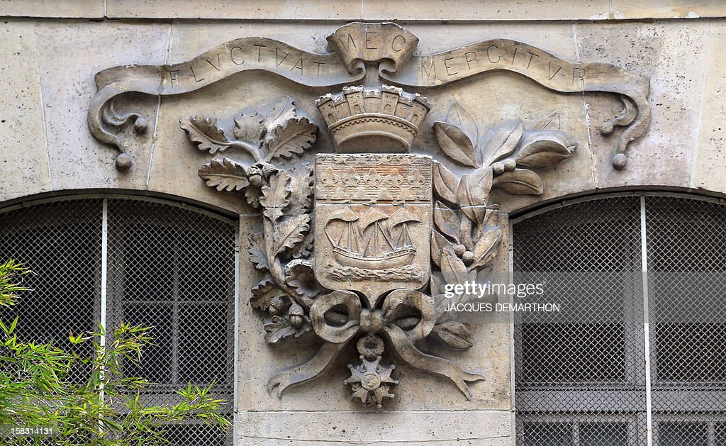 A picture taken on December 13 2012 in Paris in the facade of a school shows the arms and the motto of the French capital The vessel represents...