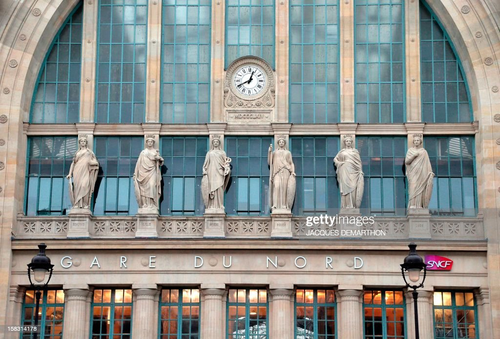 A picture taken on December 13, 2012 in Paris shows partially the facade of the Paris Gare du Nord railway station. The satues represent the symbols of France northern towns : Beauvais, Lille, Amiens, Rouen, Arras and Laon.