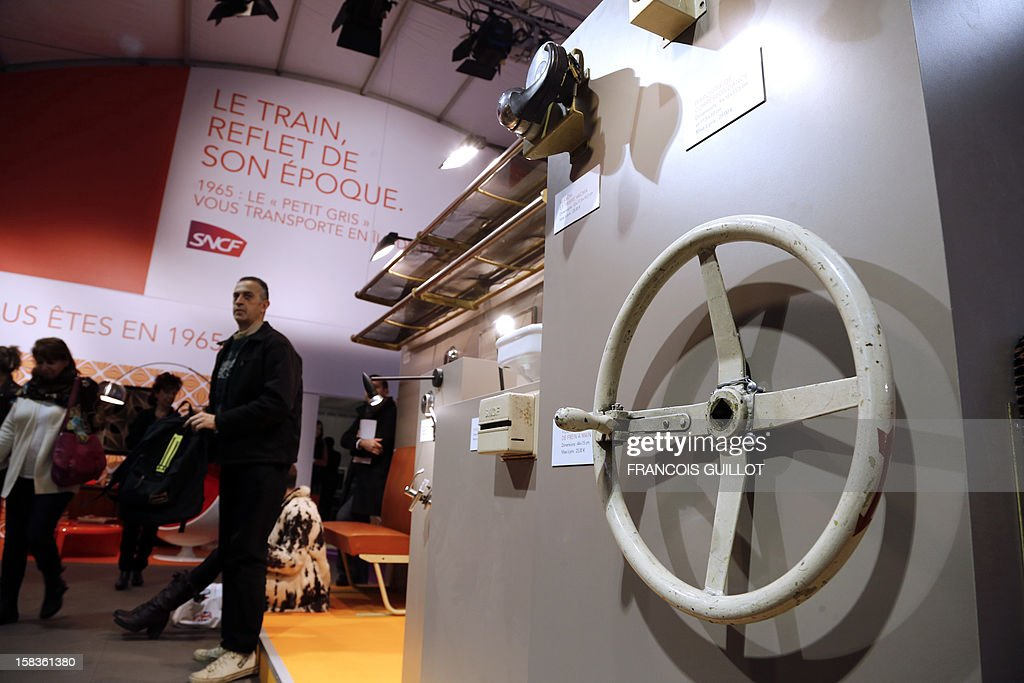 A picture taken on December 14, 2012 shows a brake wheel expected to fetch 25 euros at an exhibition called 'Le train, reflet de son époque' which displays old train items to be auctioned on December 18 in favour of the French charitable organisation 'Les Restos du Coeur' (Restaurants of the Heart) in Paris. France national rail company SNCF is set to offer more than 150 vintage items of the last Z6100 series trains from the 1960's. AFP PHOTO / FRANCOIS GUILLOT