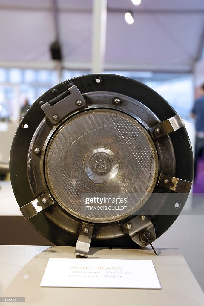 A picture taken on December 14, 2012 shows a locomotive headlight expected to fetch 30 euros at an exhibition called 'Le train, reflet de son époque' which displays old train items to be auctioned on December 18 in favour of the French charitable organisation 'Les Restos du Coeur' (Restaurants of the Heart) in Paris. France national rail company SNCF is set to offer more than 150 vintage items of the last Z6100 series trains from the 1960's. AFP PHOTO / FRANCOIS GUILLOT