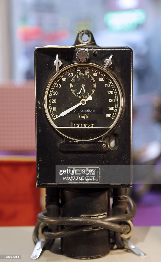 A picture taken on December 14, 2012 shows a speed indicator and recorder expected to fetch 100 euros at an exhibition called 'Le train, reflet de son époque' which displays old train items to be auctioned on December 18 in favour of the French charitable organisation 'Les Restos du Coeur' (Restaurants of the Heart) in Paris. France national rail company SNCF is set to offer more than 150 vintage items of the last Z6100 series trains from the 1960's.