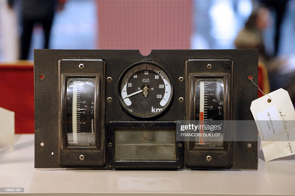 A picture taken on December 14, 2012 shows a speedometer expected to fetch 100 euros at an exhibition called 'Le train, reflet de son époque' which displays old train items to be auctioned on December 18 in favour of the French charitable organisation 'Les Restos du Coeur' (Restaurants of the Heart) in Paris. France national rail company SNCF is set to offer more than 150 vintage items of the last Z6100 series trains from the 1960's. AFP PHOTO / FRANCOIS GUILLOT