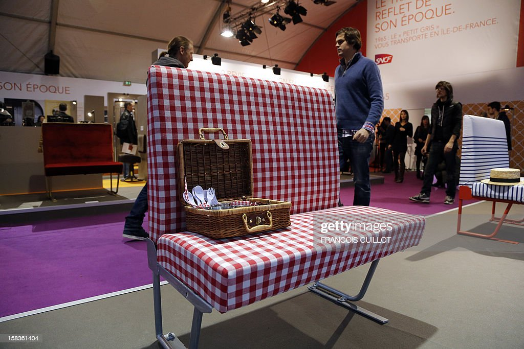 A picture taken on December 14, 2012 shows seats revisited by designers expected to fetch 80 euros at an exhibition called 'Le train, reflet de son époque' which displays old train items to be auctioned on December 18 in favour of the French charitable organisation 'Les Restos du Coeur' (Restaurants of the Heart) in Paris. France national rail company SNCF is set to offer more than 150 vintage items of the last Z6100 series trains from the 1960's.