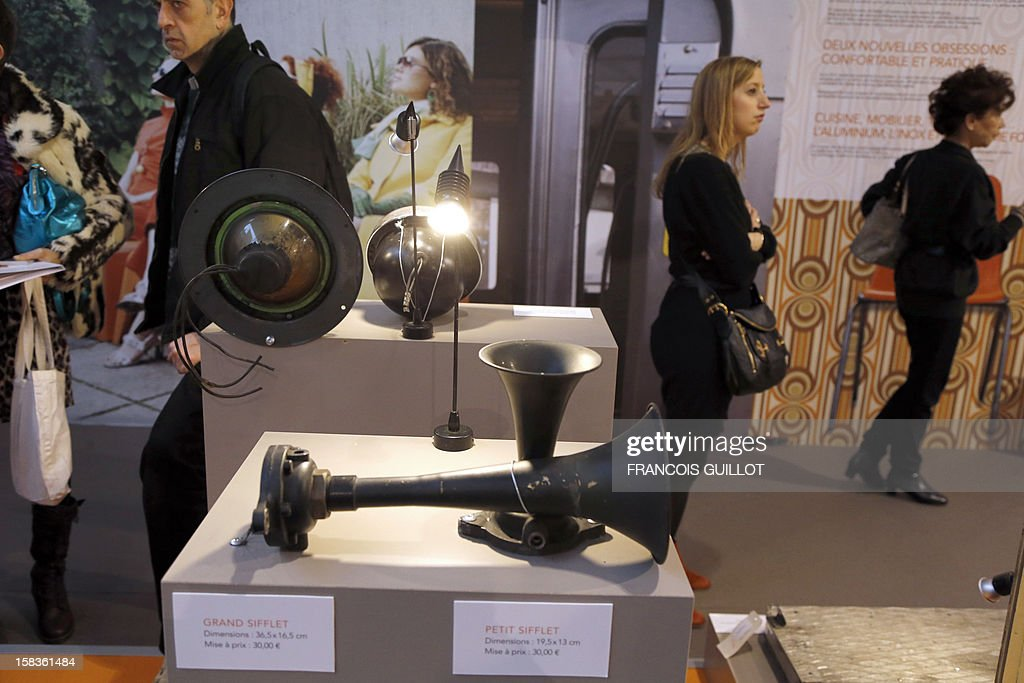 A picture taken on December 14, 2012 shows train whistles expected to fetch 30 euros each at an exhibition called 'Le train, reflet de son époque' which displays old train items to be auctioned on December 18 in favour of the French charitable organisation 'Les Restos du Coeur' (Restaurants of the Heart) in Paris. France national rail company SNCF is set to offer more than 150 vintage items of the last Z6100 series trains from the 1960's.